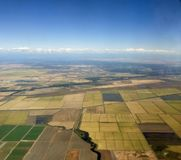 Aerial view of cultivated land. And white clouds royalty free stock photo