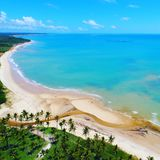Aerial view of Cumuruxatiba beach, Prado, Bahia, Brazil. Drone view of Cumuruxatiba beach with blue sea and clear weather, Prado city, Bahia state, Brazil royalty free stock photos