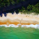 Aerial view of Cumuruxatiba beach, Prado, Bahia, Brazil. Aerial view of Cumuruxatiba beach with red sand and some people walking, city of Prado, Bahia, Brazil royalty free stock photography