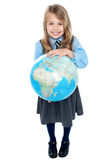 Aerial view of cute girl kid holding globe Stock Image
