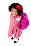 Aerial view of cute girl pointing upwards. Pretty school kid looking and pointing upwards, aerial view Stock Image