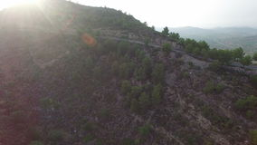 Aerial view of cyclist on high slope mountain road stock video footage