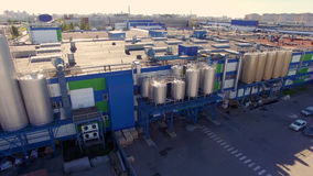 Aerial view of the dairy plant in the industrial area of the city stock footage