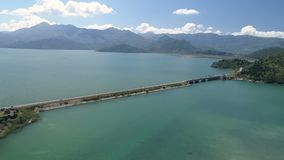 Aerial view at the dam with railroad and vehicular bridge leading through the Skadar lake. Route from Podgorica to. Adriatic coast. Montenegro stock video footage