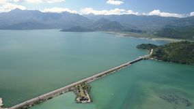 Aerial view at the dam with railroad and vehicular bridge leading through the Skadar lake. Route from Podgorica to. Adriatic coast. Montenegro stock footage