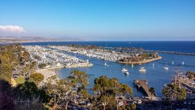 Aerial View of Dana Point Harbor, California. Afternoon aerial view of beautiful Dana Point Harbor in Southern California with a view down the coast Royalty Free Stock Photos