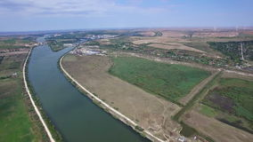 Aerial view of Danube river, windmills on the background, Cernavoda, Romania. Hd video stock video