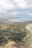 Aerial view of Dar Es Salaam. Aerial view of the city of Dar Es Salaam along the shores of the Indian Ocean showing the densely packed buildings Royalty Free Stock Image