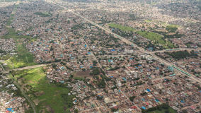 Aerial view of Dar Es Salaam. Aerial view of the city of Dar Es Salaam  showing the densely packed houses and  buildings Royalty Free Stock Images