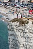 Aerial view daredevil standing at high cliff in Normandy, France Royalty Free Stock Images