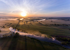 Aerial view of the dawn over the river in the fog Stock Photography