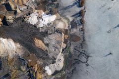 Aerial view of degraded landscape. Destroyed land. View from above. Industrial place. Photo captured with drone.  stock images