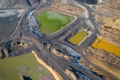 Aerial view of degraded landscape. Destroyed land. View from above. Industrial place. Photo captured with drone.  stock image