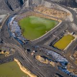 Aerial view of degraded landscape. Destroyed land. View from above. Industrial place. Photo captured with drone.  royalty free stock image