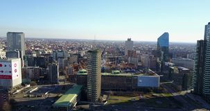 Aerial view of 360 degrees of the center of Milan, Vertical Forest, Unicredit Tower, Palazzo Lombardia, Torre Solaria, Italy stock video footage