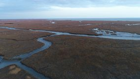 Aerial view of Delaware Bay marsh winter colors New Jersey stock video