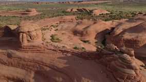 Aerial view of a delicate arch and rock formations in Arches National Park in Utah
