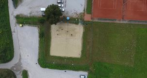 AERIAL view descending to beach volleyball court. stock video