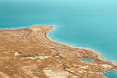 Deserted coast on Dead Sea in Israel. Aerial view on deserted coast and turquoise surface of Dead Sea in Israel Royalty Free Stock Images