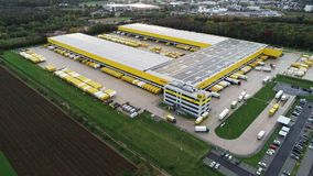 Aerial view of Deutsche Post DHL Group€™s parcel distribution hub. Obertshausen, Germany - October 16, 2019: Aerial view of Deutsche Post stock video footage