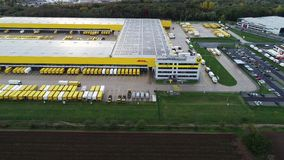 Aerial view of Deutsche Post DHL Group€™s parcel distribution hub. Obertshausen, Germany - October 16, 2019: Aerial view of Deutsche Post stock footage
