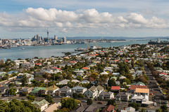 Aerial view of Devonport with Auckland skyline Royalty Free Stock Photos