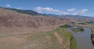 Aerial view of a dirt road and river 4k 24fps. Aerial view of a dirt road and river stock video