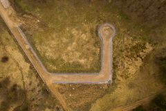 Aerial view of dirt road and roundabout royalty free stock images
