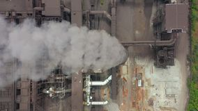 Aerial view. Dirty smoke and smog from pipes of steel factory and blast furnaces. stock video footage