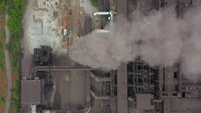 Aerial view. Dirty smoke and smog from pipes of steel factory and blast furnaces. stock video