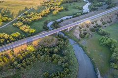 Aerial view of Dismal River in Nebraska. Aerial view of a highway and bridge over the Dismal River in Nebraska Sandhills near Thedford, spring scenery lit by Royalty Free Stock Images