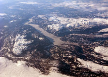 Aerial view of the distant scandinavian fiord. Mountains and clouds royalty free stock photos