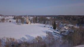 Church Winter field Krimulda Latvia aerial drone top view 4K UHD video. Aerial view DJI pro drone top view 4K UHD video stock video footage