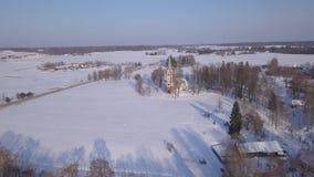 Church Winter field Krimulda Latvia aerial drone top view 4K UHD video. Aerial view DJI pro drone top view 4K UHD video stock footage