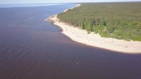 Gauja river Latvia drain into Baltic Sea aerial drone top view 4K UHD video. Aerial view DJI pro drone top view 4K UHD video stock footage