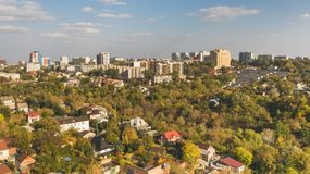 Aerial view of Dnepr cityscape with cloudy blue sky at autumn. Panoramic aerial view of Dnepr cityscape on the background of cloudy blue sky at autumn from the stock photos
