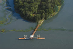 Aerial view of dock and island Stock Photos