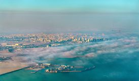 Aerial view of Doha through the morning fog - Qatar, the Persian Gulf Stock Image