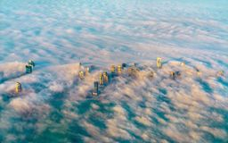 Aerial view of Doha through the morning fog - Qatar, the Persian Gulf royalty free stock photography