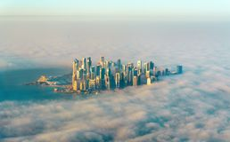 Aerial view of Doha through the morning fog - Qatar, the Persian Gulf Stock Photo
