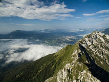 Aerial view of Dolomite Mountains. Valley, clouds fog Royalty Free Stock Photo