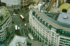Aerial view of double-decker bus on London streets. A bird`s-eye view of an intersection in central London, showing double decker bus, people and cars Royalty Free Stock Image