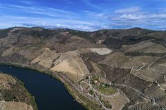 Aerial view of the Douro River and the surrounding terraced slopes and a wine making estate in Portugal Royalty Free Stock Images