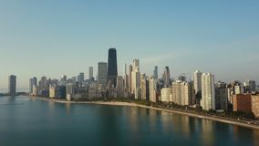 Aerial view of the downtown of Chicago, America and Michigan lake. Copter flying up to downtown on the dawn. stock video