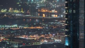 Aerial view from Downtown of Dubai to port night timelapse. Aerial view from Downtown of Dubai night timelapse with skyscrapers, houses and port Rashid on a stock video