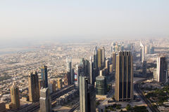 Aerial view of downtown Dubai showing commercial buildings and a dusty skyline. Aerial view of downtown Dubai UAE showing commercial buildings and a dusty Royalty Free Stock Photos