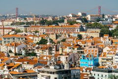 Aerial View Of Downtown Lisbon Skyline Of The Old Historical City And 25 de Abril Bridge 25th April Bridge Stock Photo
