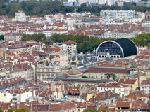 Aerial view of downtown Lyon France. Aerial view of a cityscpae of downtown Lyon in France with plenty of red roofs and white old buildings including the opera Stock Photography