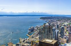 Aerial view of downtown Seattle districts. The waterfront and Elliott Bay on a sunny day. Seattle skyline, WA, USA stock photos