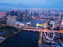 Aerial view of Downtown Singapore city in Marina Bay area. Financial district and skyscraper buildings at night.  royalty free stock images